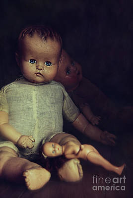 Old Dolls Sitting On Wooden Table Poster