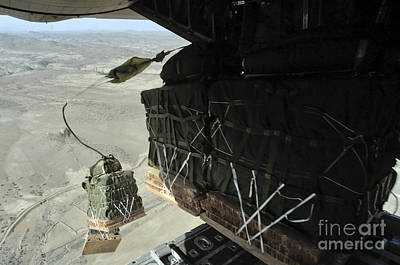 Pallets Roll Out Of A C-130 Hercules Poster