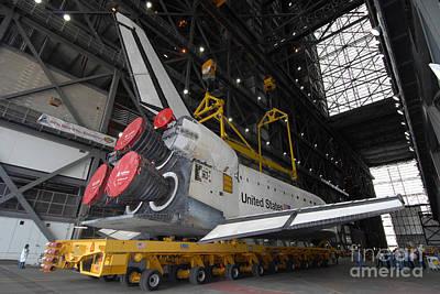 Space Shuttle Atlantis Rolls Poster by Stocktrek Images