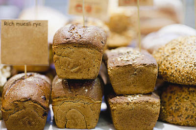 Stacks Of Fresh Bread For Sale Poster by Hybrid Images