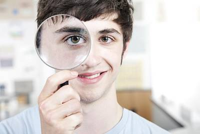 Teenage Boy With Magnifying Glass Poster by
