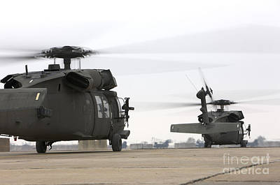 Two Uh-60 Black Hawks Taxi Poster by Terry Moore