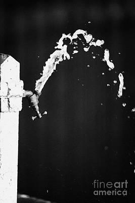 Upside Down Faucet Spraying Water Poster by Joe Fox