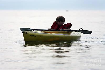 Young Boy Paddling Kayak Poster