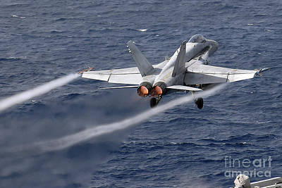 An Fa-18c Hornet Launches Poster by Stocktrek Images