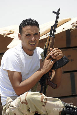 A Rebel Fighter With An Ak-47 Assault Poster