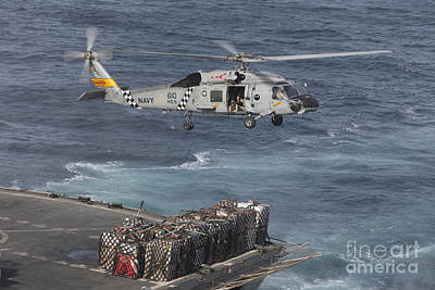 A Sh-60j Seahawk Conducts A Vertical Poster