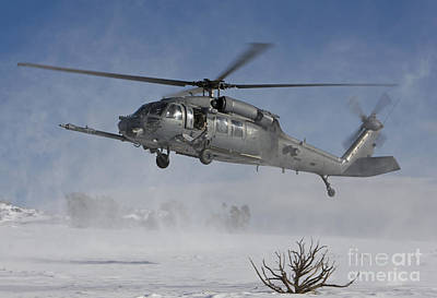 An Hh-60g Pave Hawk Flys Low Poster