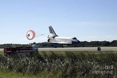 Space Shuttle Atlantis Unfurls Its Drag Poster