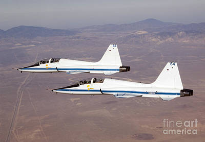 Two T-38a Mission Support Aircraft Fly Poster by Stocktrek Images