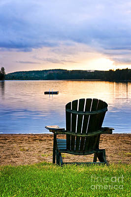 Wooden Chair At Sunset On Beach Poster
