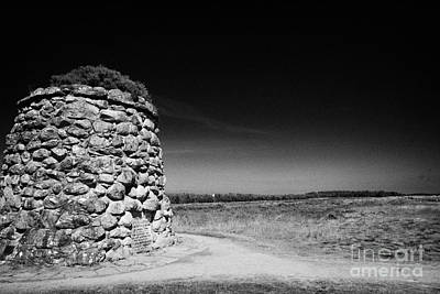 the memorial cairn on Culloden moor battlefield site highlands scotland Poster