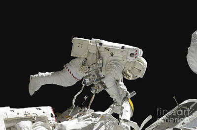 Astronaut Working On The International Poster by Stocktrek Images