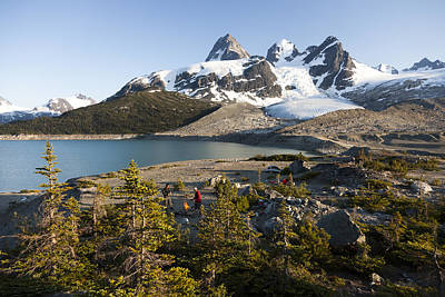 A Campsite Next To A Blue Glacier Fed Poster