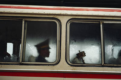 A Chinese Pla Soldier Sits On A Bus Poster