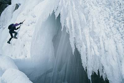 A Climber Scales An Ice Formation Poster