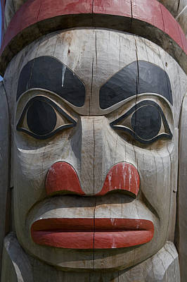 A Close View Of The Carvings Of A Totem Poster