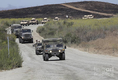 A Convoy Of Military Vehicles Poster