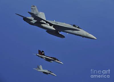 A Fa-18c Hornet Flies Near Two Fa-18f Poster