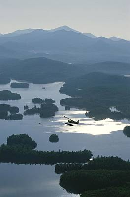 A Floatplane Flies Over Long Lake Poster by James P. Blair