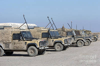 A Group Of Snatch Land Rover Patrol Poster by Andrew Chittock