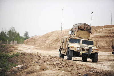 A Humvee Conducts Security Poster