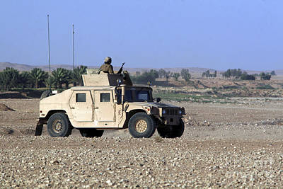 A Humvee Filled With Marines Conducting Poster
