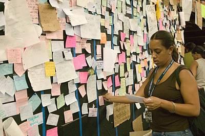 A Hurricane Katrina Survivor Checks Poster