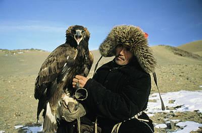 A Kazakh Eagle Hunter Poses Poster