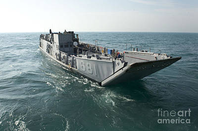A Landing Craft Utility Transits Poster by Stocktrek Images