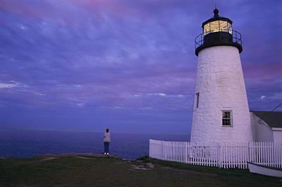 A Lighthouse Visitor Enjoys A Twilight Poster by Stephen St. John
