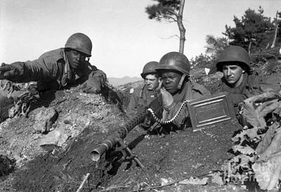 A Machine Gun Crew In Firing Position Poster by Stocktrek Images