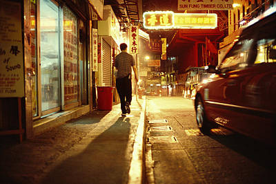 A Man And A Taxi On A Shop-lined Hong Poster