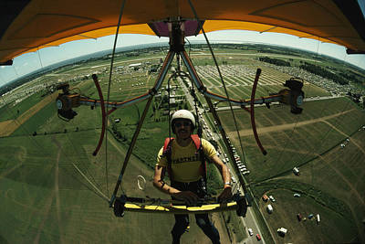 A Man Flies In A Hang Glider Powered Poster by James A. Sugar