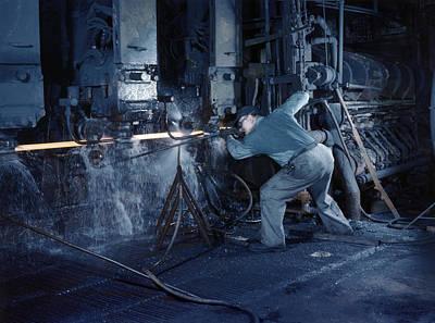 A Man Operates A Machine Rolling Flat Poster