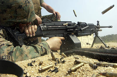 A Marine Engages Targets With An M-249 Poster