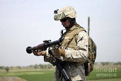 A Marine Looks At A Brand New Poster by Stocktrek Images