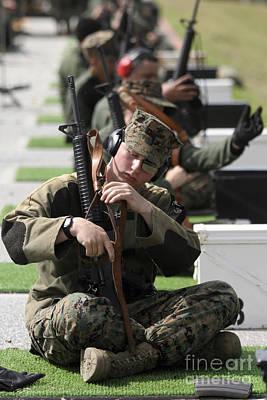A Marine Makes Final Adjustments Poster