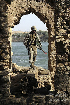 A Marine Searching A Stone Aqueduct Poster by Stocktrek Images
