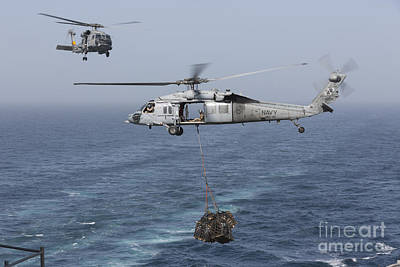 A Mh-60s Knighthawk Transfers Cargo Poster by Gert Kromhout