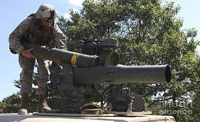 A Missileman Loads A Tow Missile Poster by Stocktrek Images
