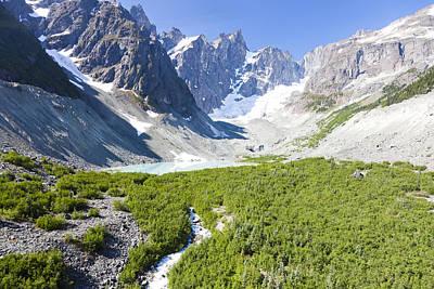 A Mountain Streams Runs From An Alpine Poster