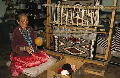 A Navajo Weaver At Her Loom Poster by David Edwards