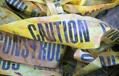 A Pile Of Discarded Caution Poster