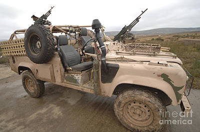 A Pink Panther Land Rover Desert Patrol Poster by Andrew Chittock