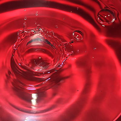 A Red Splash Of Water Poster