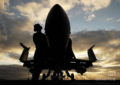 A Sailor Cleans The Nose Of An Fa-18f Poster