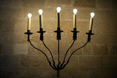 A Sconce With Illuminated Electric Candles Poster by Mark Gerum