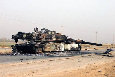 A Scuttled Abrams Tank Rests In Front Poster
