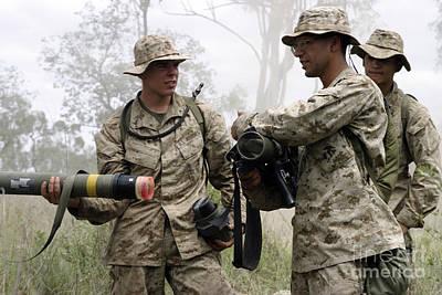 A Soldier Assists A Mortarman Poster